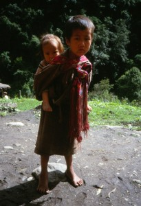 Boy carrying sibling